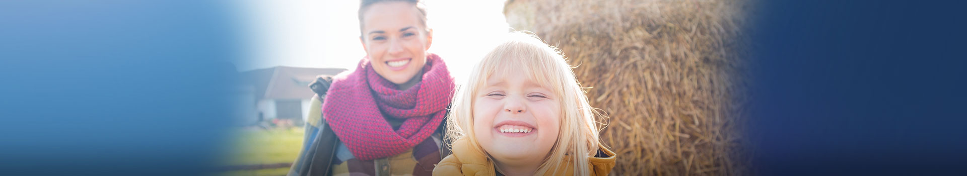 Young mom with daughter smiling outside