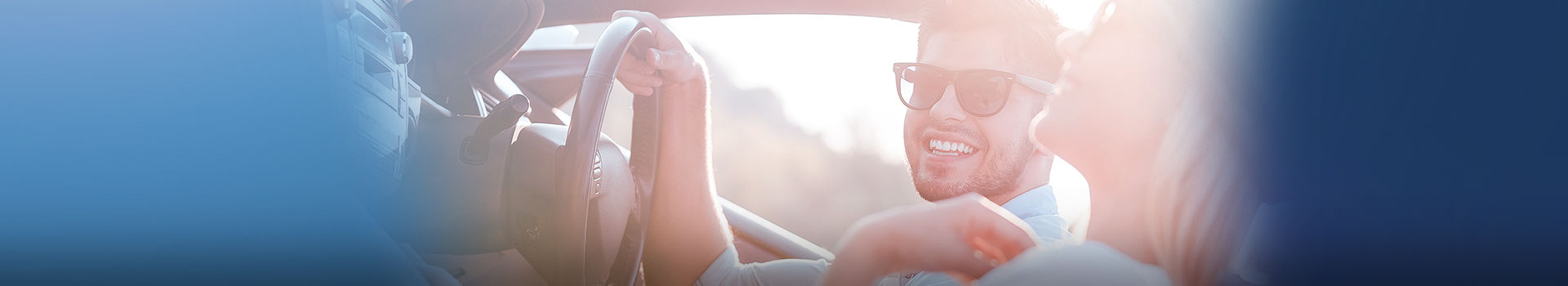 young man in sunglasses driving