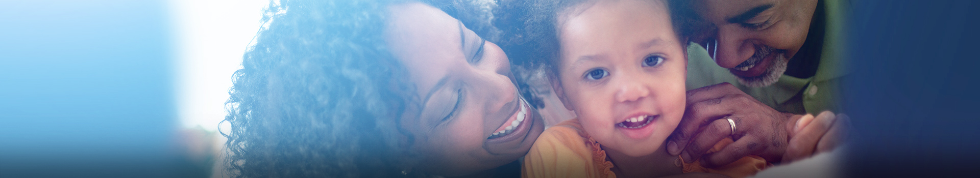 African American couple with infant daughter smiling